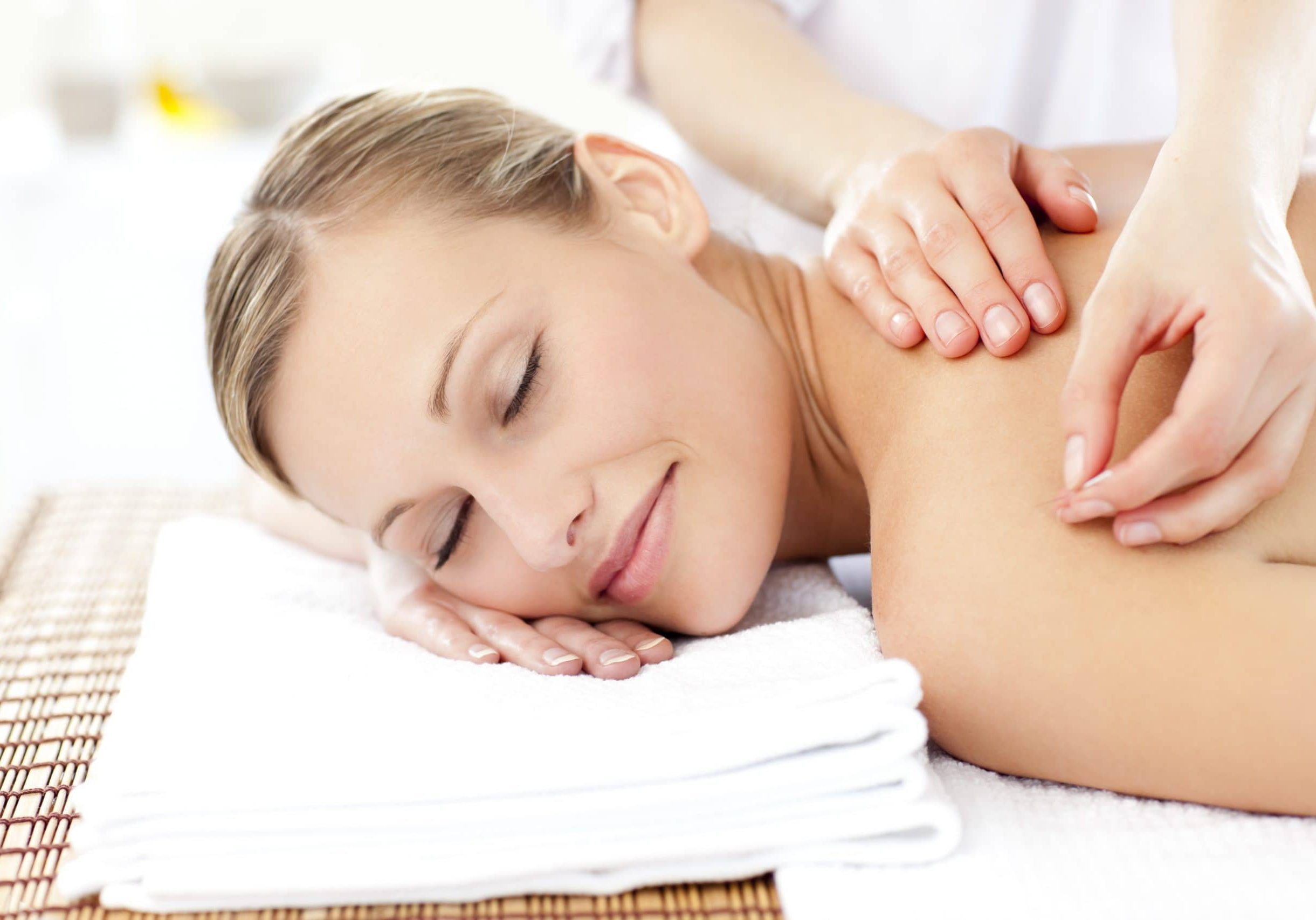Radiant woman receiving an acupuncture treatment in a health spa